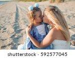 happy mother in the wedding...   Shutterstock . vector #592577045