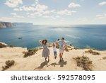happy family of four walking in ... | Shutterstock . vector #592578095