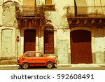 An Old Small Car Standing On A...