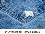 gum sticking on jean | Shutterstock . vector #592618811