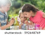 three children having a snack... | Shutterstock . vector #592648769