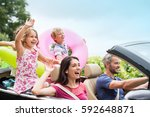 a joyful family  in a... | Shutterstock . vector #592648871