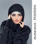 woman in a muslim headscarf... | Shutterstock . vector #592650341