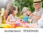 three generations family... | Shutterstock . vector #592654181