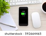 phone with charged battery... | Shutterstock . vector #592664465