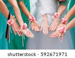 hands of the bride and... | Shutterstock . vector #592671971