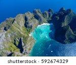 top view of tropical island... | Shutterstock . vector #592674329