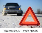 car accident on winter road.... | Shutterstock . vector #592678685