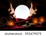 hands of fortune teller with... | Shutterstock . vector #592679075