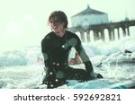 three surfers practicing in the ... | Shutterstock . vector #592692821
