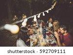 group of friends making... | Shutterstock . vector #592709111