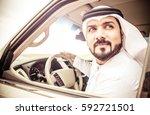 arabic man in his luxury car | Shutterstock . vector #592721501