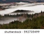 mist over scottish highlands ... | Shutterstock . vector #592735499