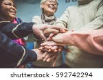 group of seniors making... | Shutterstock . vector #592742294