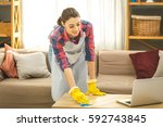 woman in protective gloves is... | Shutterstock . vector #592743845
