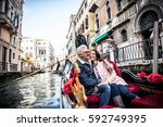 happy couple on romantic... | Shutterstock . vector #592749395