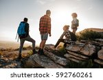 group of hikers on top of hill... | Shutterstock . vector #592760261