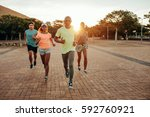 portrait of young runners on... | Shutterstock . vector #592760921