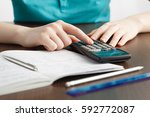 girl solving a math problem in... | Shutterstock . vector #592772087