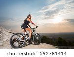 woman cyclist in the sunglasses ...   Shutterstock . vector #592781414