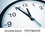 5 min before 12 o clock on a... | Shutterstock . vector #592786439