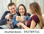 three happy friends talking and ... | Shutterstock . vector #592789721
