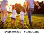 back view of family with... | Shutterstock . vector #592802381