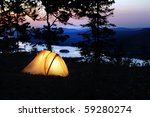 a tent lit up at dusk | Shutterstock . vector #59280274
