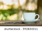 coffee cup with coffee beans on ... | Shutterstock . vector #592833311