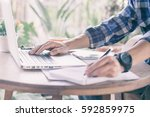 businessman working with laptop ... | Shutterstock . vector #592859975