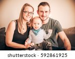 smiling family portrait of... | Shutterstock . vector #592861925