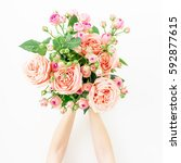 Stock photo beautiful bouquet with pink roses in girl hands isolated on white background flat lay top view 592877615