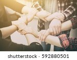 a group of young people hold... | Shutterstock . vector #592880501