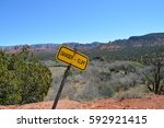 a yellow warning sign on a... | Shutterstock . vector #592921415