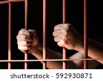 close up hand of woman prisoner ... | Shutterstock . vector #592930871