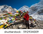 pray flags in everest base camp | Shutterstock . vector #592934009