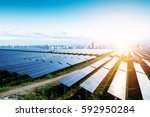 solar panels with the sunny sky.... | Shutterstock . vector #592950284