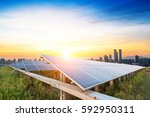 solar panels with the sunny sky.... | Shutterstock . vector #592950311