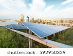 solar panels with the sunny sky.... | Shutterstock . vector #592950329