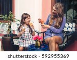 mom with her 6 years old...   Shutterstock . vector #592955369