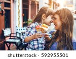 mom with her 6 years old... | Shutterstock . vector #592955501