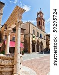 """Small photo of Pienza, Tuscany. Main square with historic well. Pienza is the """"ideal city"""" or the """"utopian city"""", it represents one of the best planned of Renaissance towns."""
