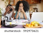 stressed unemployed husband... | Shutterstock . vector #592973621