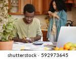 stressed african male in... | Shutterstock . vector #592973645