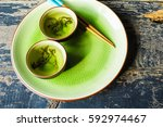 green tea and leaves on rustic... | Shutterstock . vector #592974467