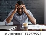 frustrated young african... | Shutterstock . vector #592979027