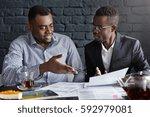 attractive african businessman... | Shutterstock . vector #592979081