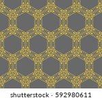 ornamental seamless pattern.... | Shutterstock . vector #592980611
