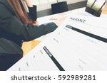 woman in suit in office showing ... | Shutterstock . vector #592989281
