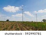 wind turbine on the blue sky... | Shutterstock . vector #592990781